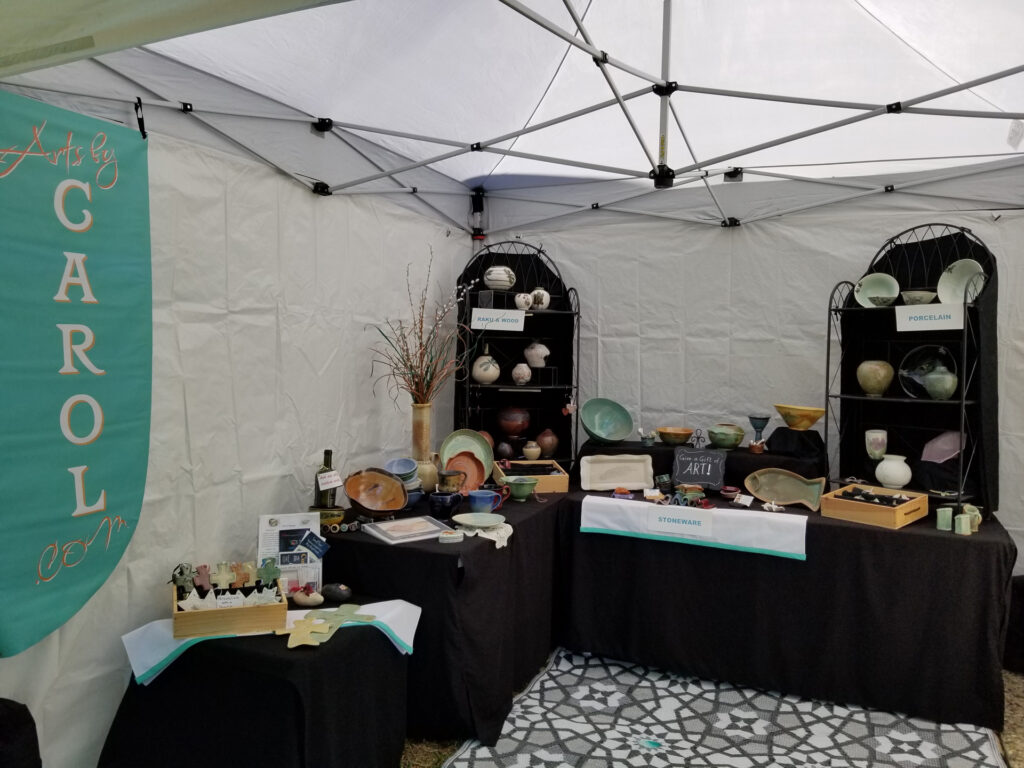 View of Pop Up tent and items for sale at the Artisan Market...now available in virtual shows
